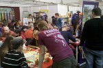 A crowded Pegasus Spiel booth at Essen 2011