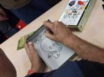 John Kovalic signing a Munchkin box
